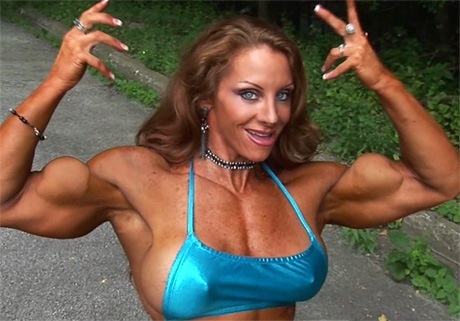Sensual Female Bodybuilder flexing her ultra strong muscles